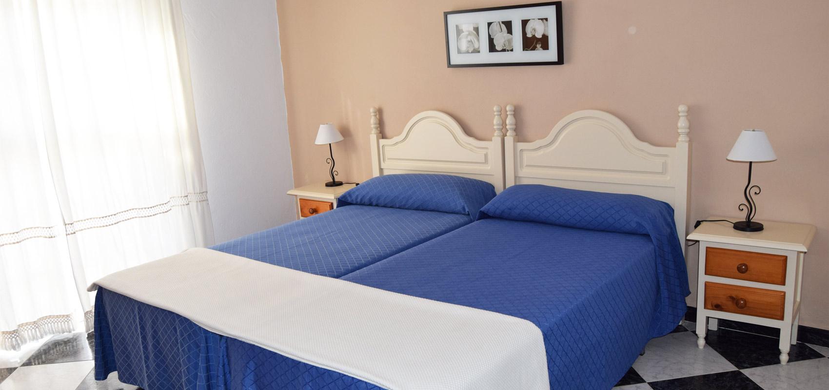 12 habitaciones hostal rosales